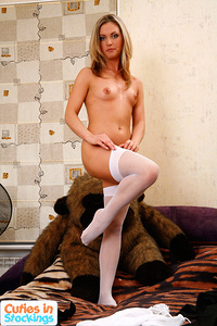 Blonde with perfectly smooth body tries on nylons