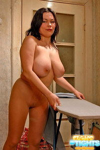 Milf with huge knockers poses in sheer pantyhose