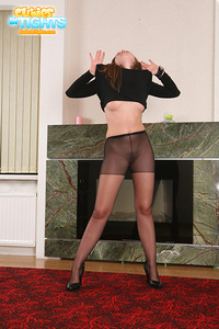 Young kitty wearing nothing except black pantyhose